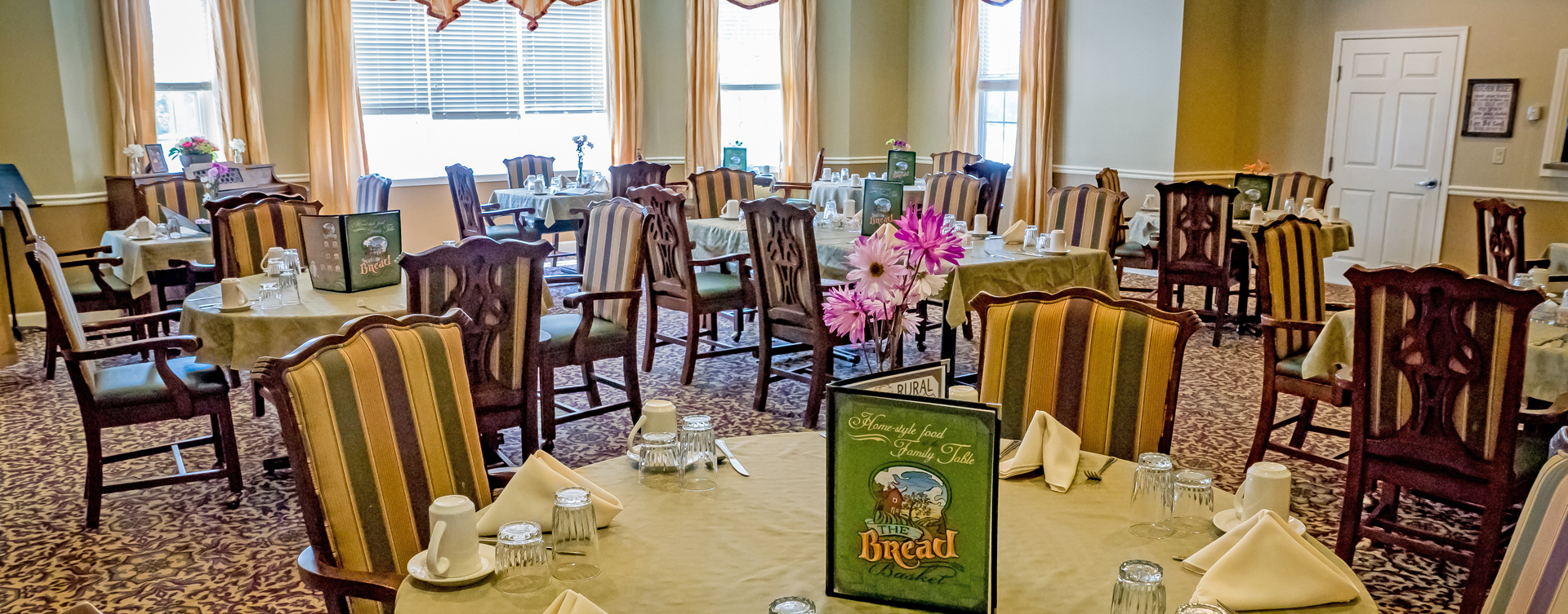 Food is best when shared with friends in the dining room at Bickford of Oswego