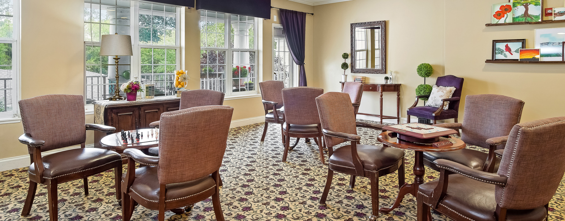 Enjoy a good card game with friends in the activity room at Bickford of Overland Park
