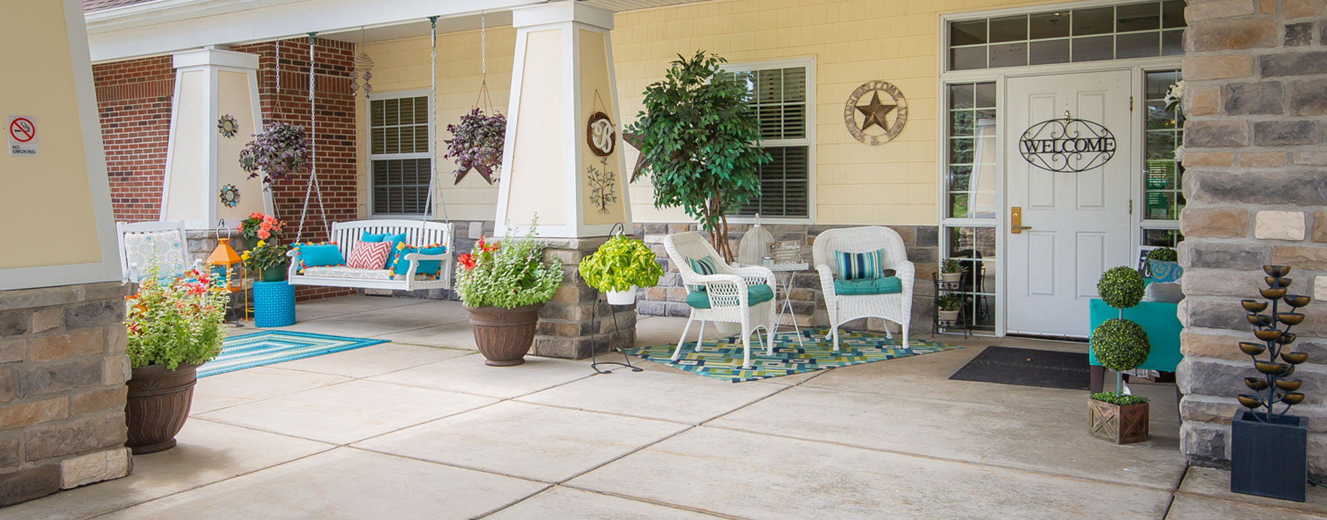 Enjoy conversations with friends on the porch at Bickford of Portage