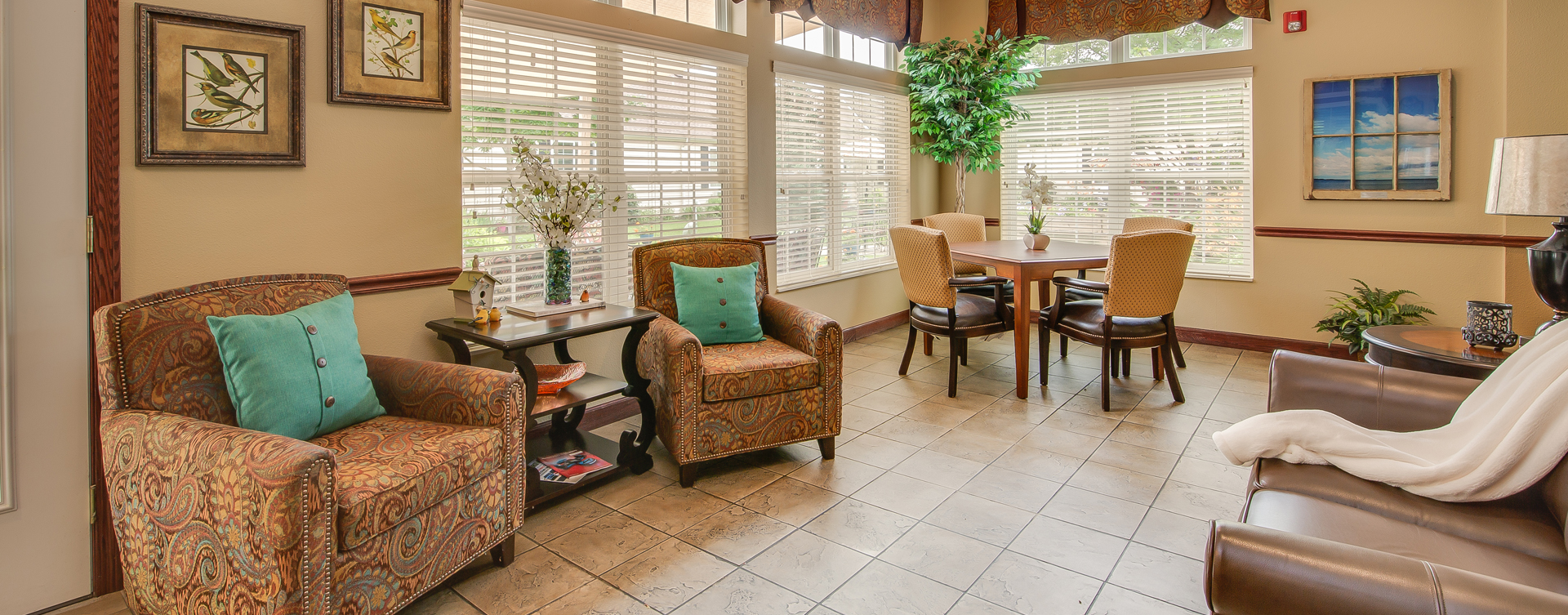 Enjoy the view of the outdoors from the sunroom at Bickford of Portage