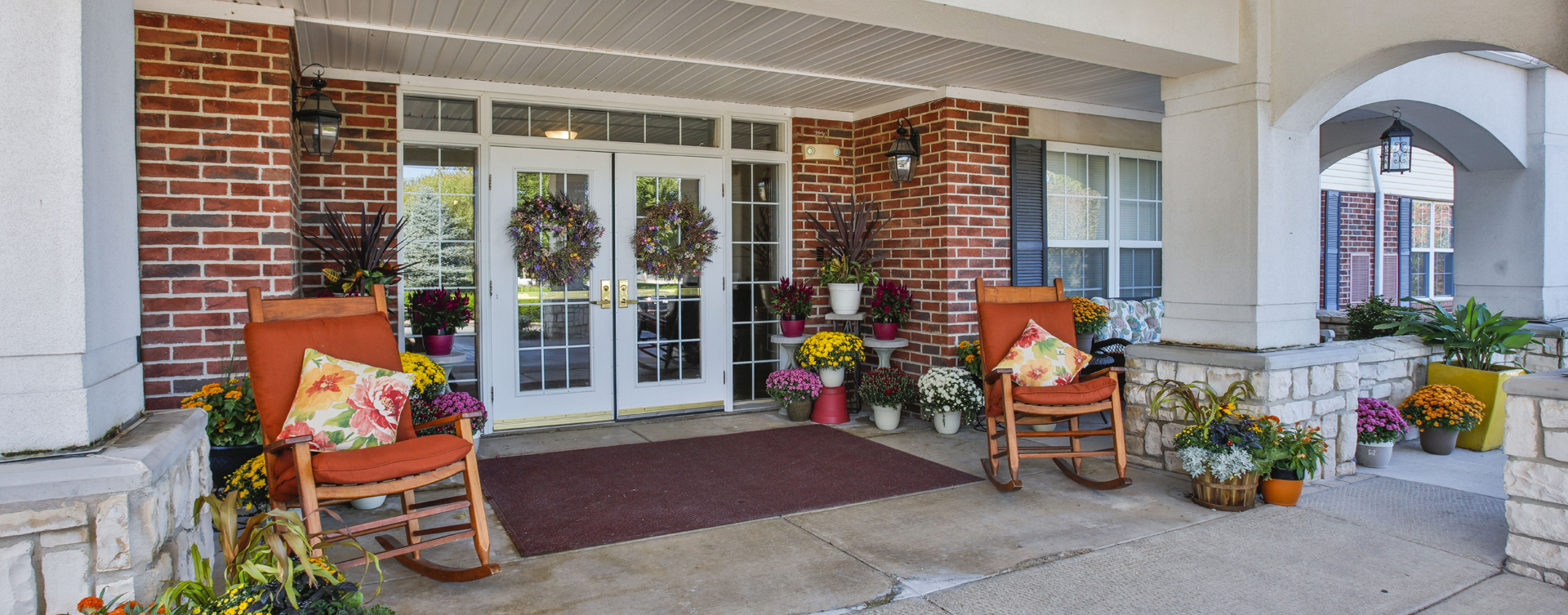 Relax in your favorite chair on the porch at Bickford of Peoria
