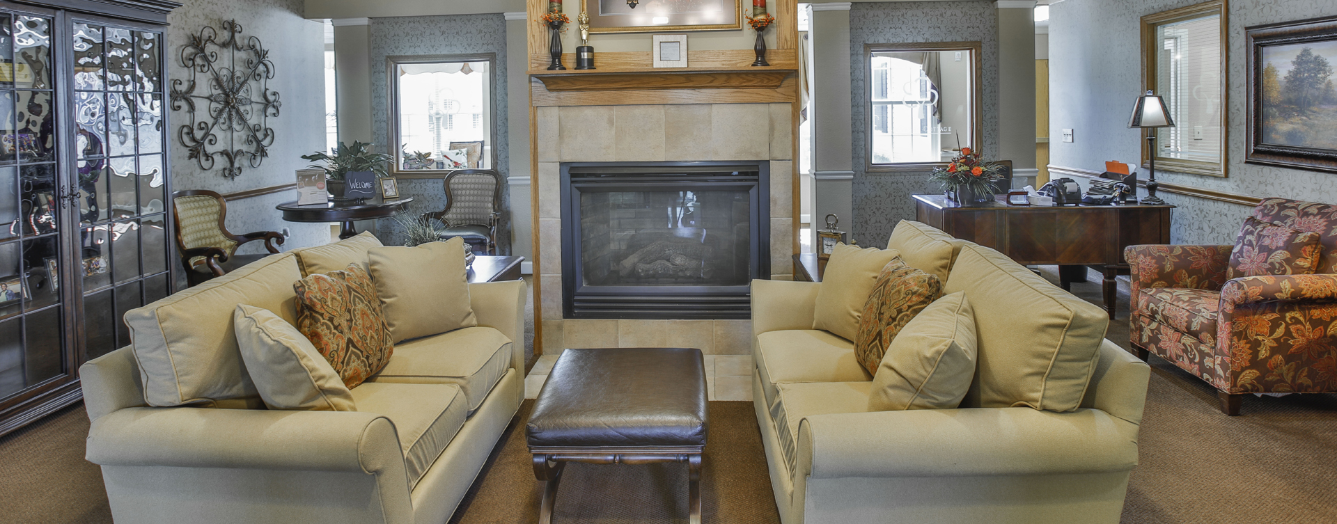 Chairs and sofas sit higher and are easier to get in and out of in the Mary B's living room at Bickford of Peoria