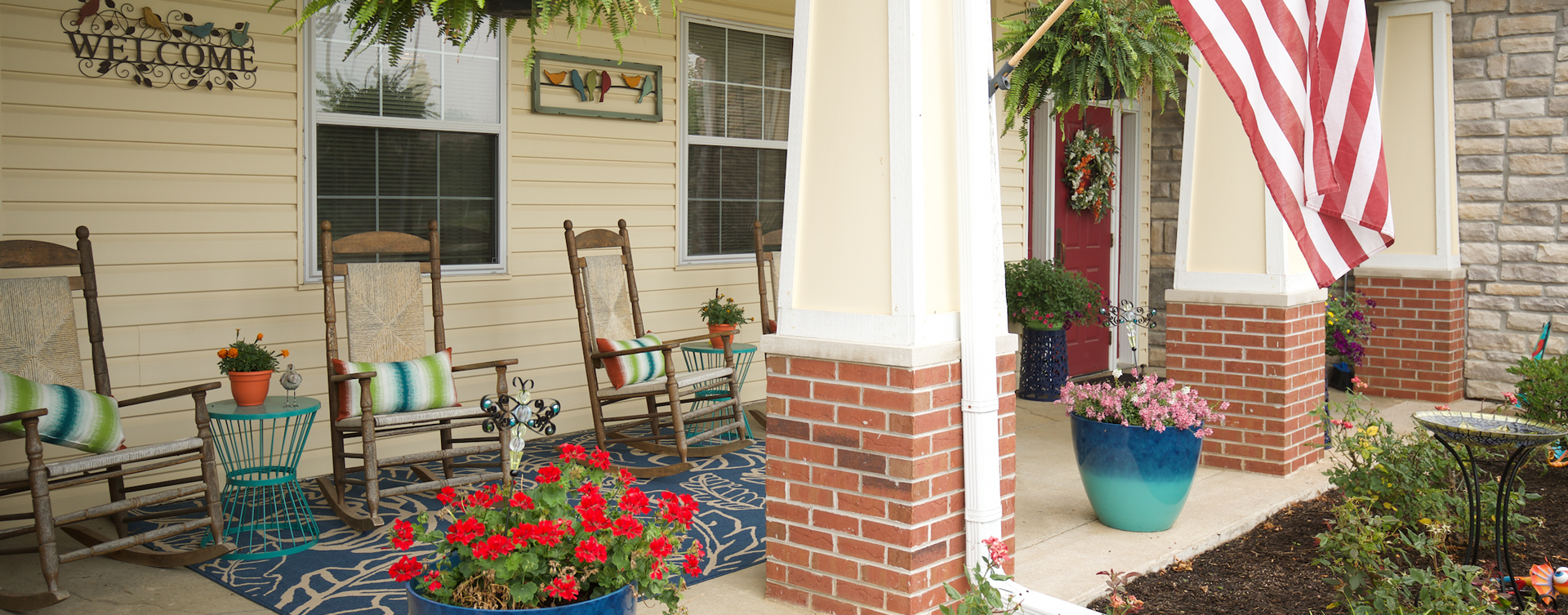 Enjoy conversations with friends on the porch at Bickford of Quincy
