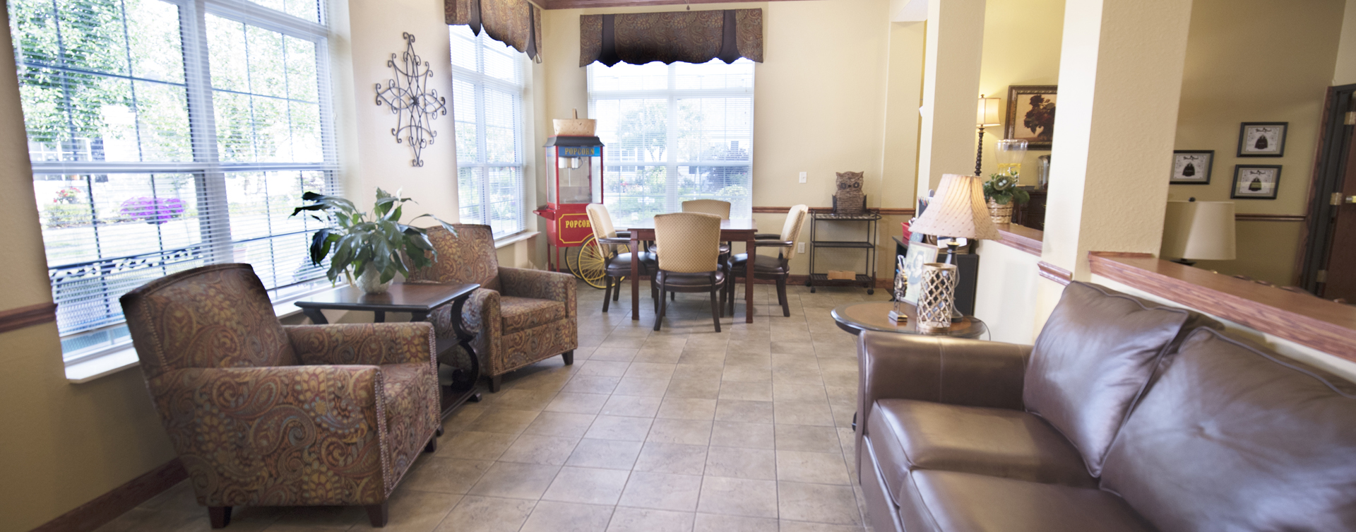 Relax in the warmth of the sunroom at Bickford of Quincy