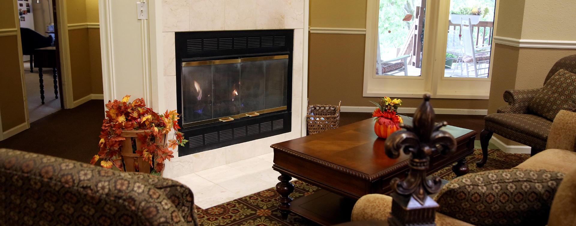 Enjoy a good book in the living room at Bickford of Rockford
