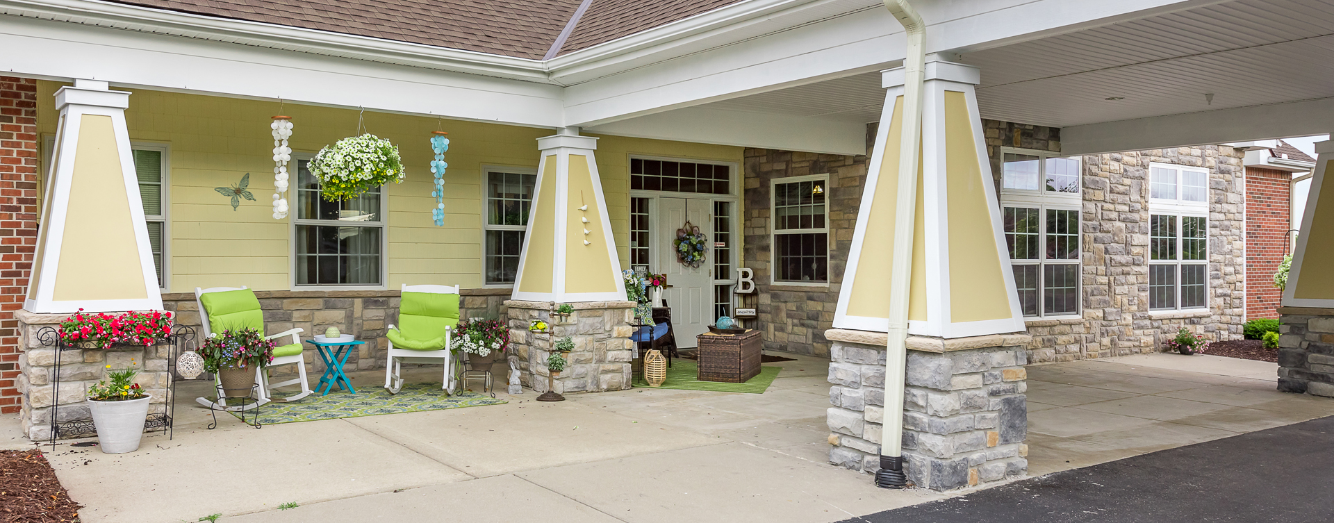 Sip on your favorite drink on the porch at Bickford of Saginaw Township
