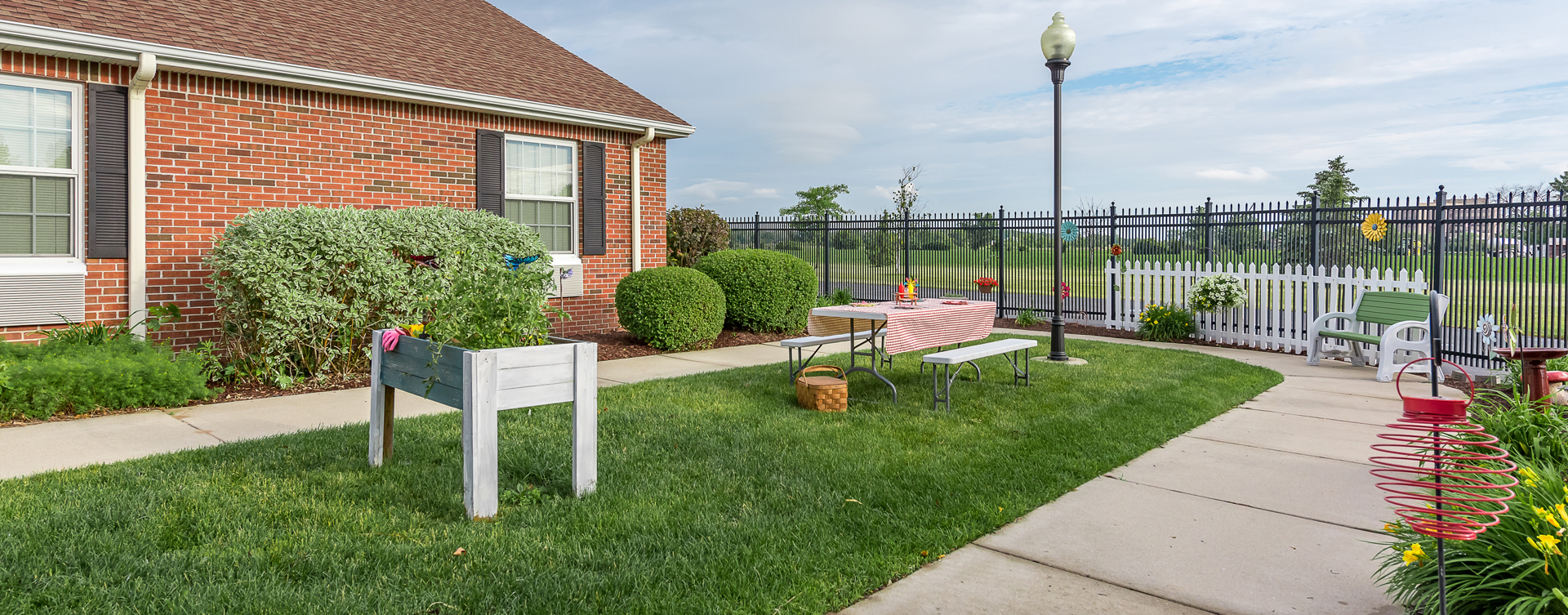 A single entrance courtyard gives residents with dementia the opportunity to be safe outside at Bickford of Saginaw Township