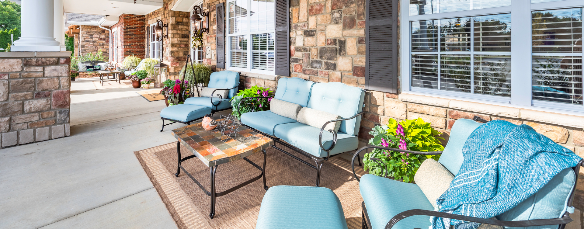Relax in your favorite chair on the porch at Bickford of Shelby Township