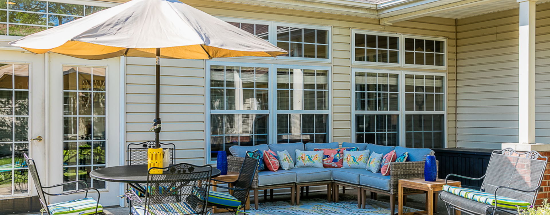 Residents with dementia can enjoy a traveling path, relaxed seating and raised garden beds in the courtyard at Bickford of Sioux City