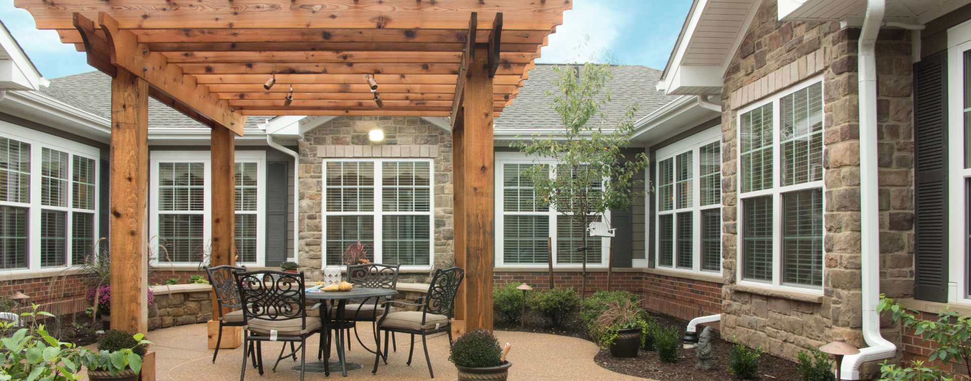 Residents with dementia can enjoy a traveling path, relaxed seating and raised garden beds in the courtyard at Bickford of Spotsylvania