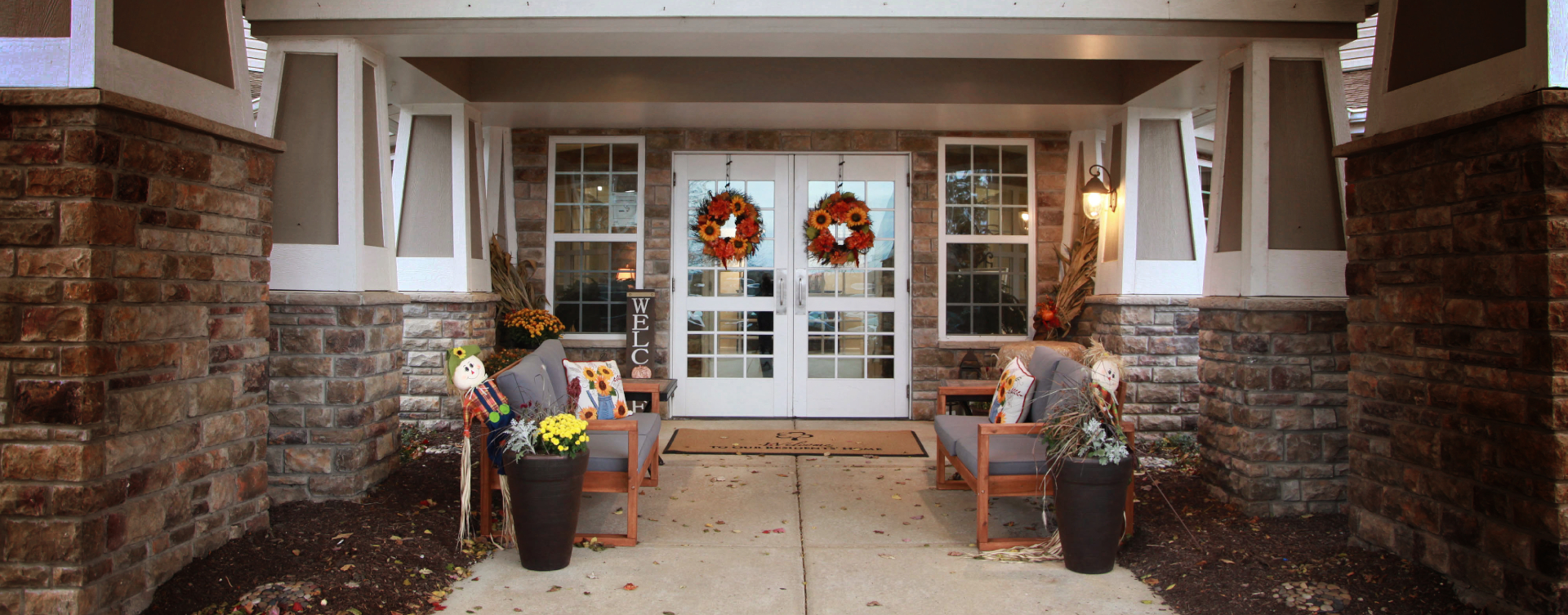 Enjoy conversations with friends on the porch at Bickford of St. Charles