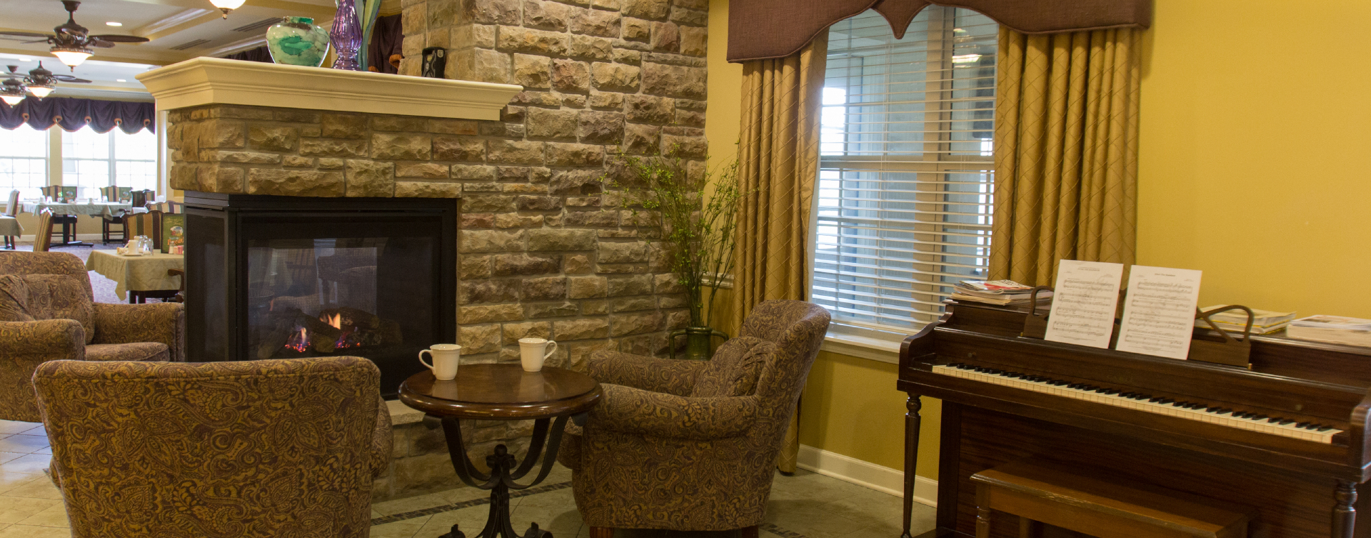 Enjoy a good book in the living room at Bickford of St. Charles