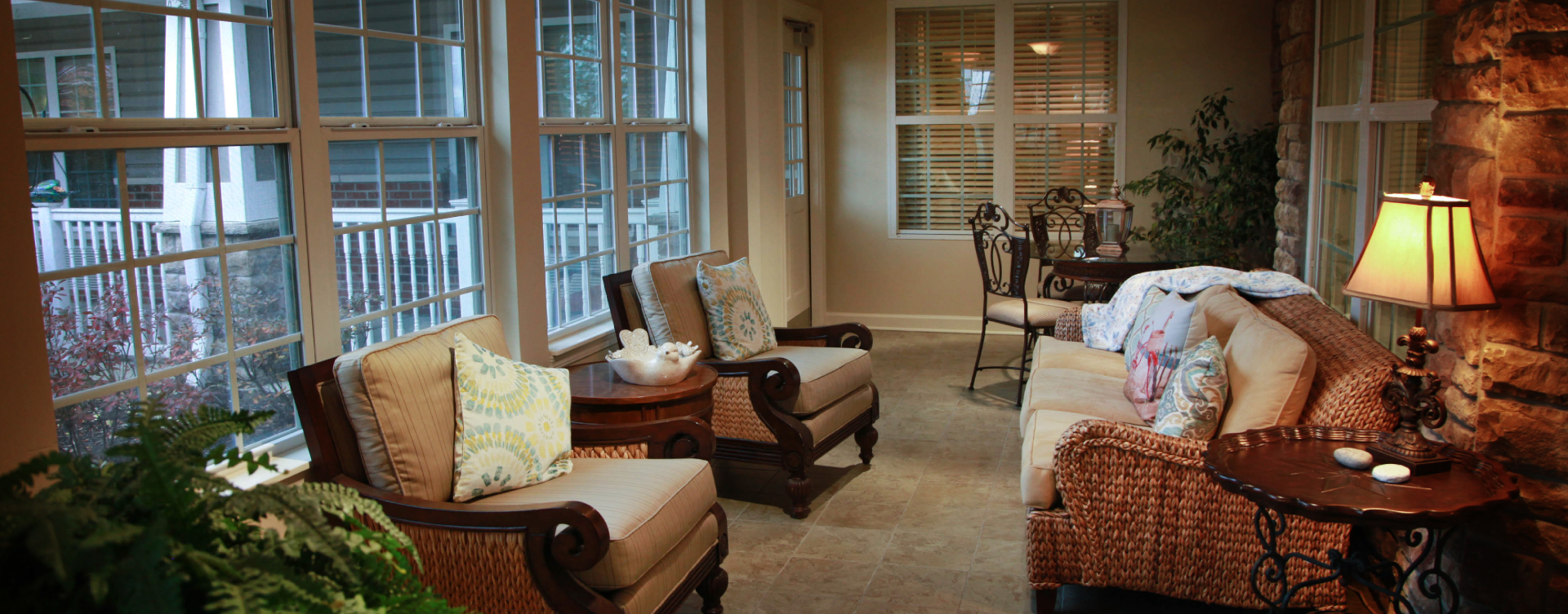 Relax in the warmth of the sunroom at Bickford of St. Charles