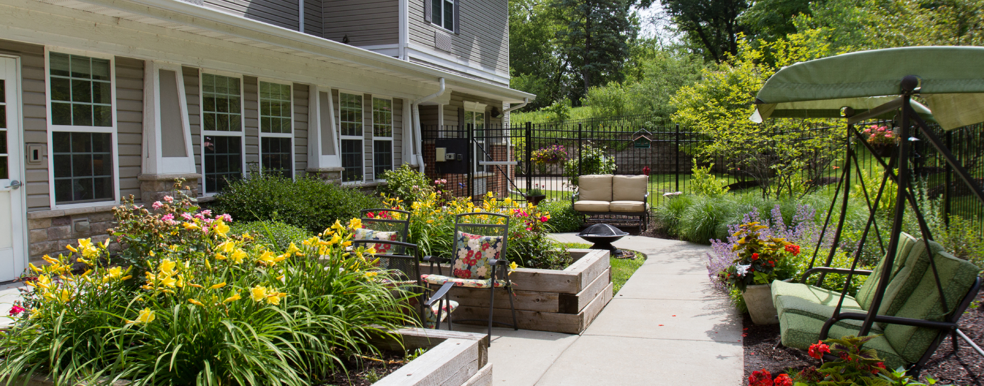 Residents with dementia can enjoy a traveling path, relaxed seating and raised garden beds in the courtyard at Bickford of St. Charles