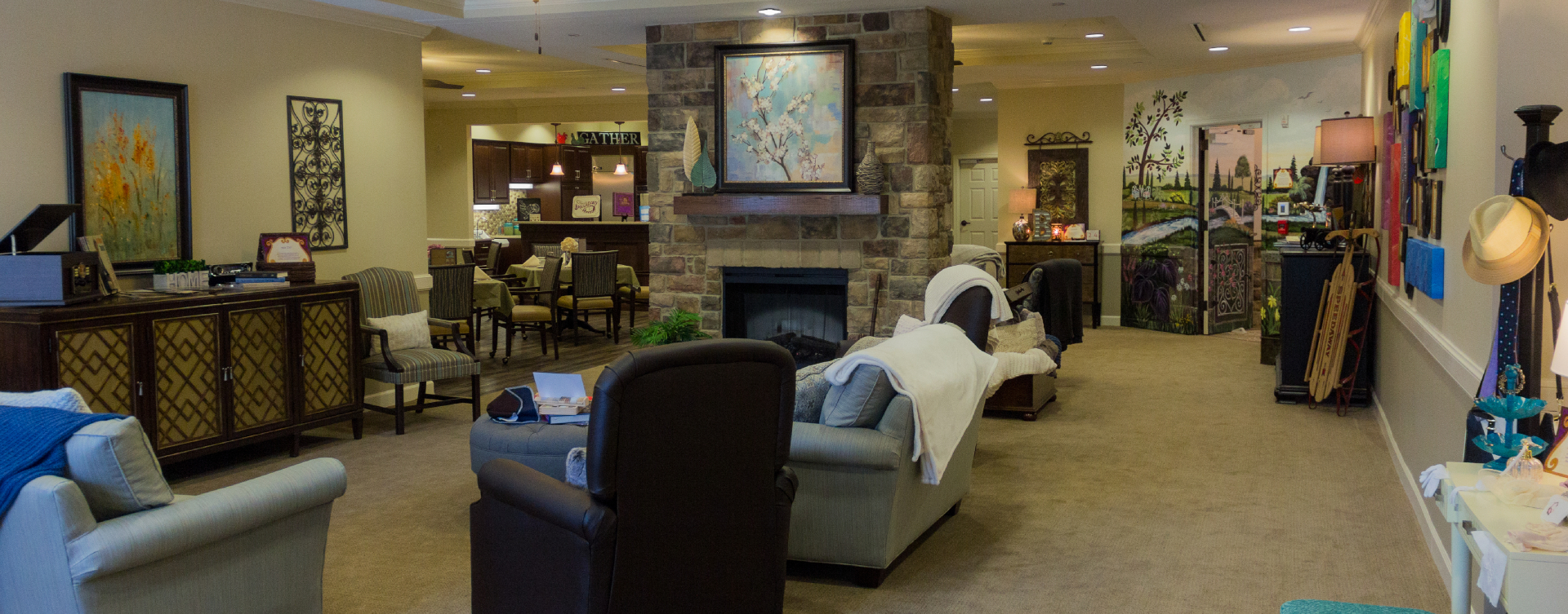 Residents can enjoy furniture covered in cozy fabrics in the Mary B's living room at Bickford of Suffolk