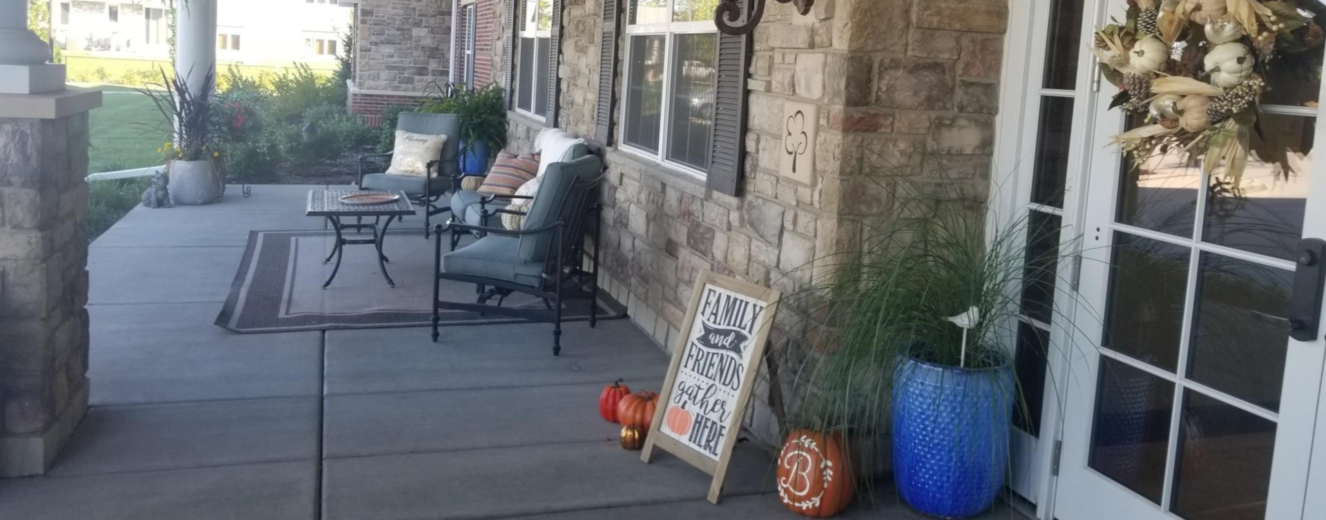 Sip on your favorite drink on the porch at Bickford of Tinley Park