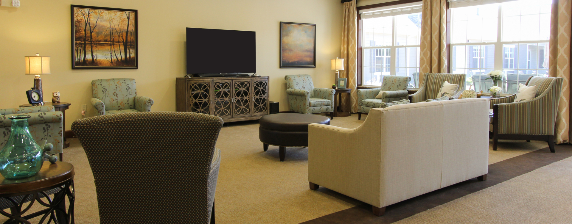 Socialize with friends in the living room at Bickford of Tinley Park
