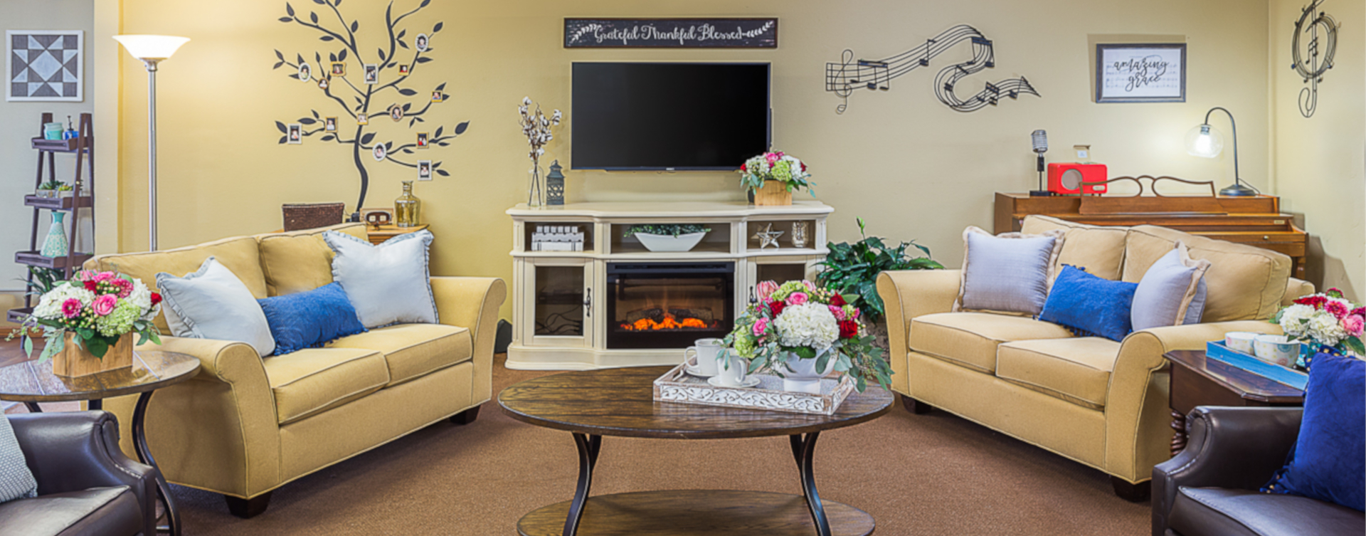 Residents can enjoy furniture covered in cozy fabrics in the Mary B's living room at Bickford of Urbandale