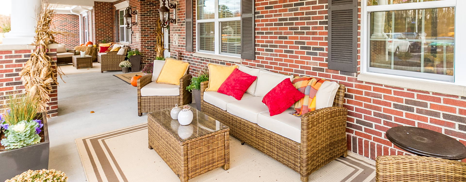 Enjoy conversations with friends on the porch at Bickford of Virginia Beach