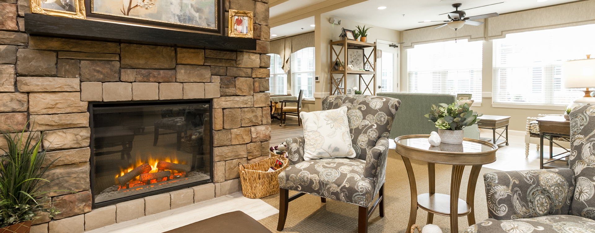 Residents can enjoy furniture covered in cozy fabrics in the Mary B's living room at Bickford of Virginia Beach