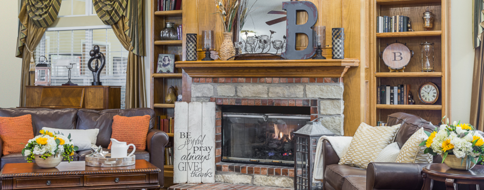 Enjoy a good book in the living room at Bickford of West Des Moines