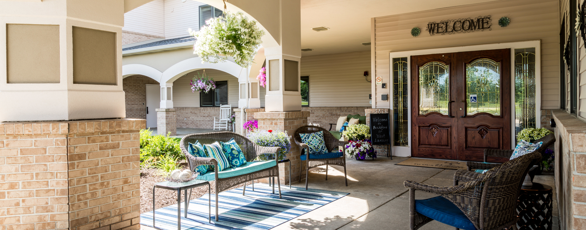 Enjoy conversations with friends on the porch at Bickford of West Lansing