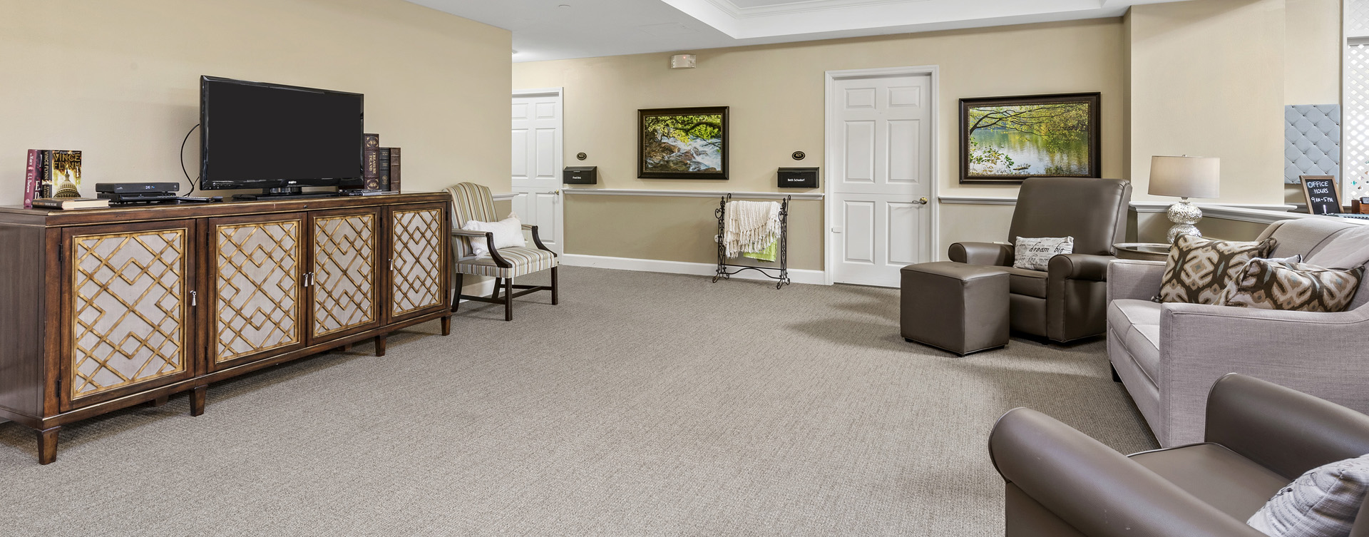 Residents can enjoy furniture covered in cozy fabrics in the Mary B's living room at Bickford of Worthington
